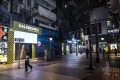 Pedestrians walk past closed stores on Russell Street in the Causeway Bay, Hong Kong. The Covid-19 pandemic has slammed tourist arrivals and retail sales for almost two years. Photo: Bloomberg