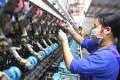 An employee at a silk reeling factory in Lingyun county in southern China's Guangxi Zhuang Autonomous Region on April 17, 2020. Photo: Xinhua/