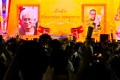 The images of historian Somsak Jeamteerasakul and former diplomat Pavin Chachavalpongpun are projected onto a giant screen during a protest at Thammasat University in Bangkok. Photo: Reuters
