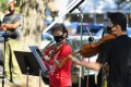 Violinist Quan Ge (lefL) and violist Cong Wu of the New York Philharmonic play in a pop-up concert in Brooklyn. Photo: AFP