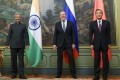 India's Foreign Minister Subrahmanyam Jaishankar, left, Russia's Foreign Minister Sergey Lavrov, and China's Foreign Minister Wang Yi, pose for a photo in Moscow on Thursday. Photo: AP