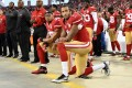 Colin Kaepernick and Eric Reid of the San Francisco 49ers kneel in protest during the national anthem prior to playing the Los Angeles Rams on September 12, 2016. Photo: AFP