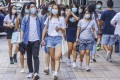 Young people walk through Tsim Sha Tsui. A survey found just over 38 per cent indicated they trusted the government. Photo: Dickson Lee