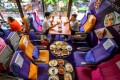 """At a Thai Airways plane-themed pop-up restaurant at the airline's headquarters, in Bangkok, would-be passengers eat """"in-flight"""" meals served on plastic trays. Photo: AFP"""