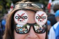Hundreds of people protested in the Polish capital Warsaw on Saturday against measures imposed to prevent the spread of the coronavirus. Photo: EPA