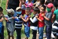 Waiting in line to take part in Children's Day celebrations in Tegucigalpa, Honduras, on September 10. To protect children from losing out on a healthy and stable future, the world needs to urgently step up with debt relief for low-income countries and fragile states. Photo: AFP