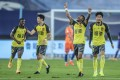 Paulinho (second from right) of Guangzhou Evergrande celebrates scoring against Shandong Luneng in the Chinese Super League. Photo: Xinhua