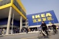 Customers cycle past a newly-opened Ikea store in Chengdu, China, on November 29, 2006. Photo: AFP