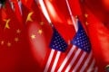 American flags are displayed together with Chinese flags in Beijing in 2018. If China and the United States continue on their current confrontational trajectory, other actors such as Asean might need to step in to prevent further global destabilisation. Photo: AP