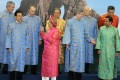 World leaders prepare for the obligatory 'family photo' at the Asia-Pacific Economic Cooperation summit, in Hanoi, in 2006. Photo: Reuters