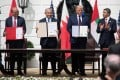 (From left) Bahrain Foreign Minister Abdullatif al-Zayani, Israeli Prime Minister Benjamin Netanyahu, US President Donald Trump and UAE Foreign Minister Abdullah bin Zayed Al-Nahyan take part in the signing of the Abraham Accords in Washington on Tuesday. Photo: AFP