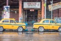 Indian yellow taxis in front of a Chinese store in Chinatown in Kolkata, India. Photo: Shutterstock