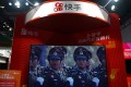 A screen showing footage of a military parade is seen at a booth of Chinese video-streaming start-up Kuaishou at the 2020 China International Fair for Trade in Services in Beijing. Photo: Reuters