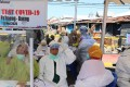 Health workers wear hazmat clothing while working on the front lines against Covid-19 in Indonesia. Patients worried about what neighbours will think have asked health workers to take them to hospital at dead of night. Photo: Shutterstock
