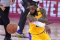 Los Angeles Lakers forward LeBron James makes a pass during the win over the Denver Nuggets. Photo: AP