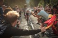Spectators cheer for Slovenian rider Tadej Pogacar as he completes stage 20 of the Tour de France. Photo: EPA