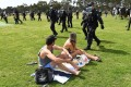 Police sweep through a park to break up an anti-lockdown protest in Melbourne on Saturday. Photo: AFP