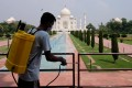A worker sanitises railings at the Taj Mahal in Agra, India, after authorities reopened the famous monument to visitors. Photo: Reuters