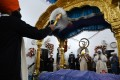 Sikh pilgrims take part in a religious ritual on the occasion of the 481st death anniversary of Guru Nanak at Gurdwara Darbar Sahib in Kartarpur, near the India-Pakistan border on Tuesday. Photo: AFP