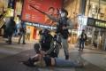 Hong Kong riot police detain a protester in Causeway Bay, Hong Kong, on June 12. Photo: AP
