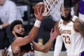 Denver Nuggets guard Jamal Murray goes up for a shot as Los Angeles Lakers' LeBron James looks on during game three of the NBA Western Conference Finals. Photo: AP