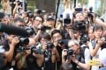 Reporters last year taking pictures of protesters outside the British consulate in Hong Kong. Photo: Rachel Cheung