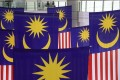 Giant Malaysian national flags hang inside a shopping centre. This year's Sabah state election has been seen as a bellwether for Malaysian politics in general. Photo: EPA