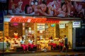 Employees waiting for customers outside a massage parlour in Pattaya. Photo: AFP