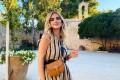 Chiara Ferragni sports a sleek brown handbag. Photo: Dior