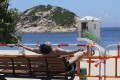 A man sunbathes behind the barricades at Shek O beach on July 26, days after Hong Kong's beaches were closed. Photo: SCMP / Dickson Lee