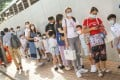 Students and parents line up outside Kingston International School in Kowloon Tong. Photo: K.Y. Cheng