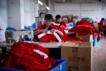 Employees make Christmas products at Fuye toy factory following the coronavirus disease (COVID-19) outbreak in Yiwu, Zhejiang province, China September. Photo: Reuters