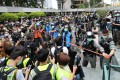 Riot police cordon off Chater Garden in Central during a rally in June as reporters and photographers crowd around. Photo: May Tse