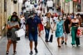 People wearing protective face masks walk on a street in Bordeaux, southwestern France. France has recently been reporting record-high daily new infections since the pandemic started. Photo: EPA-EFE