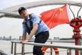 Jiang says he always wanted to be a police officer. Photo: AFP