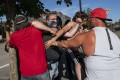 Black Lives Matter protesters and Trump supporters get into a scuffle in Clackamas, Oregon, on August 29. Photo: AFP