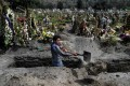 A gravedigger works at the San Miguel Xico cemetery in Mexico on Thursday, amid the Covid-19 coronavirus pandemic. Photo: AFP