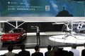XPeng CEO He Xiaopeng unveils its Kiwigogo flying car, right, at the 2020 Beijing International Automobile Exhibition on Saturday September 26, 2020. Photo: Simon Song