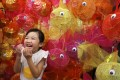A young Hongkonger poses for a photo with fish-themed lanterns crafted for this year's Mid-Autumn Festival. Photo: Sam Tsang