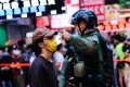 A police officer tells a man to move away during an anti-government protest in Hong Kong on September 6. Photo: dpa