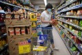 A woman shops at a supermarket in Whampoa on August 19. Photo: Winson Wong