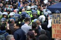 Police clash with protesters at a rally in Trafalgar Square in London on Saturday. Thousands of people turned out to attend the 'We Do Not Consent' rally to protest against new government coronavirus restrictions and vaccinations. Photo: EPA-EFE