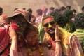Roushan playing Holi with Chinese tourists. Photo: Manish Kumar (aka Roushan)