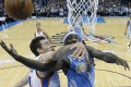 Denver Nuggets guard Ty Lawson is fouled by Oklahoma City Thunder forward Nick Collison in an NBA game in 2013. Photo: AP