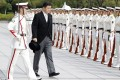 Japan's defence minister, Nobuo Kishi, receives a guard of honour during a ceremony in Tokyo a day after he took up the post. Photo: Kyodo