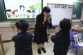 A coach with autistic children at a primary school in Hong Kong. The coronavirus pandemic has disrupted educational and therapy services for students with special needs. Photo: Jonathan Wong