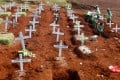 Workers prepare new graves for victims of the coronavirus at a cemetery in Jakarta, Indonesia. Photo: Reuters