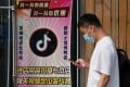 A man walks past a restaurant with the TikTok app logo displayed in the window in Beijing on September 14. A US court in Washington has granted temporary legal relief to TikTok against a Trump administration ban on the short video-sharing service. Photo: Agence France-Presse
