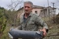 A man holds the remains of a rocket shell in Nagorno-Karabakh on Monday. Photo: Armenian Foreign Ministry handout via dpa
