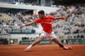 Novak Djokovic plays a shot against Austria's Dominic Thiem in Rome last week. He has vowed to be on his best behaviour in Paris. Photo: AP